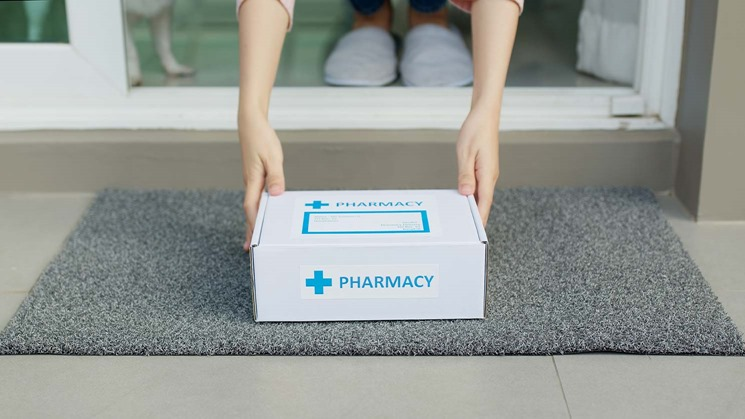 A pharmacy courier service delivers a package