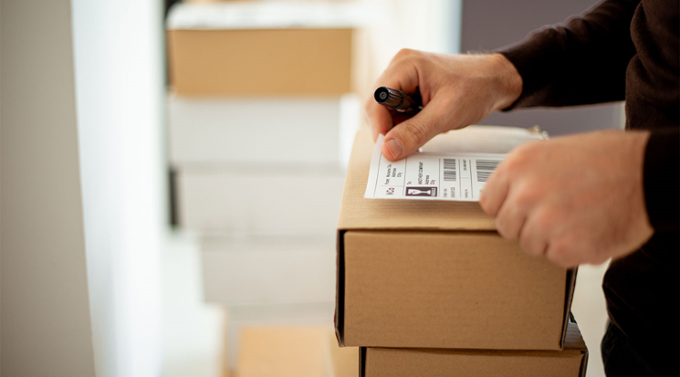Small business owner creates shipping label